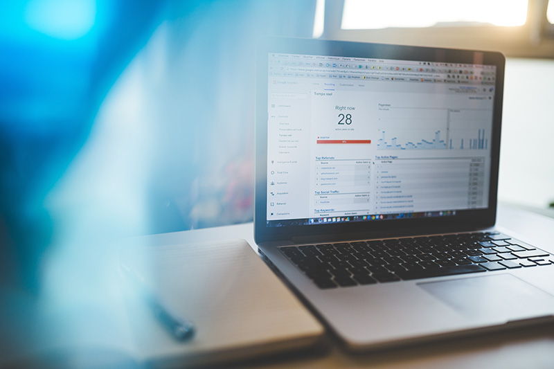 Internet and Online Marketing Services. Image of laptop and Website Analytics in Calgary